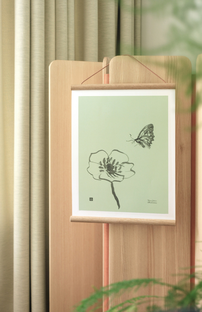 Mint green butterfly poster on a wooden poster frame