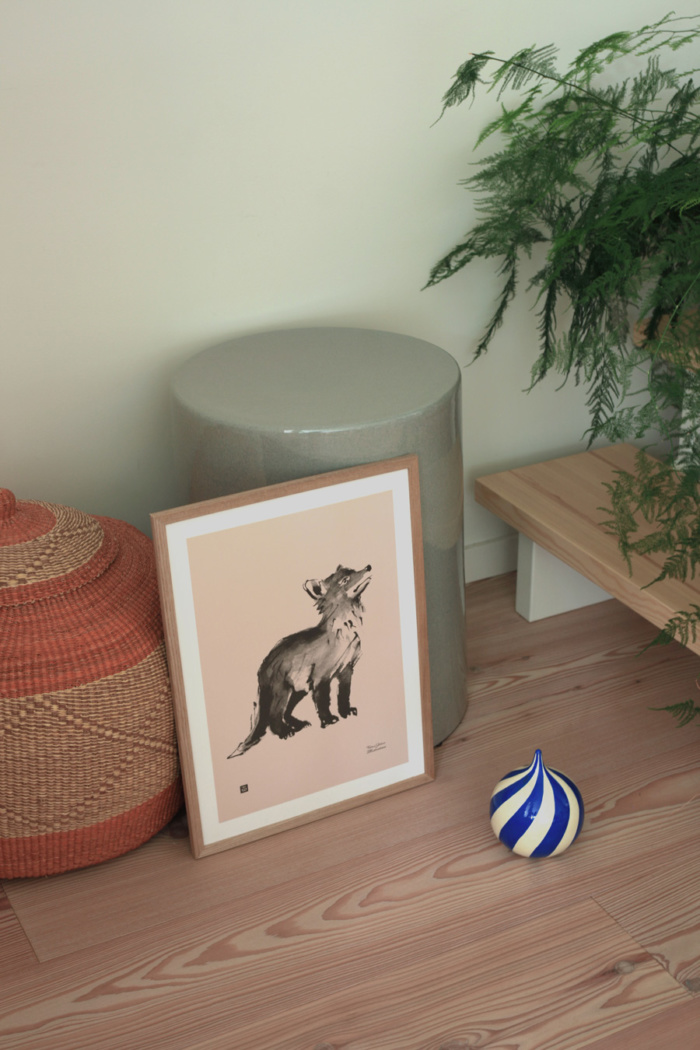 Old rose fox cub poster on a wooden frame on a floor