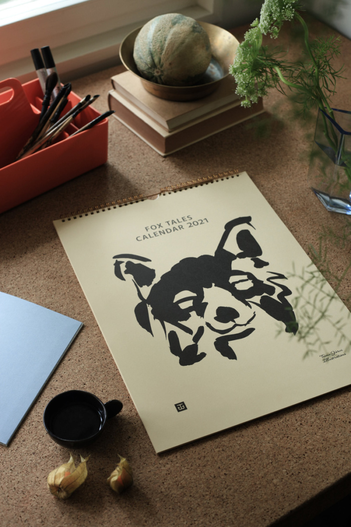 Fox tales Wall Calendar on a desk